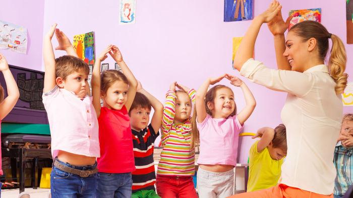 Children imitating teacher's hand gesture