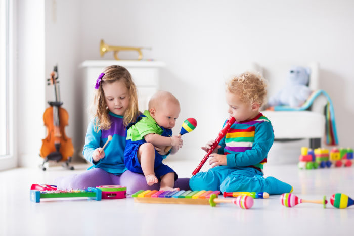 Three little siblings with musical instruments