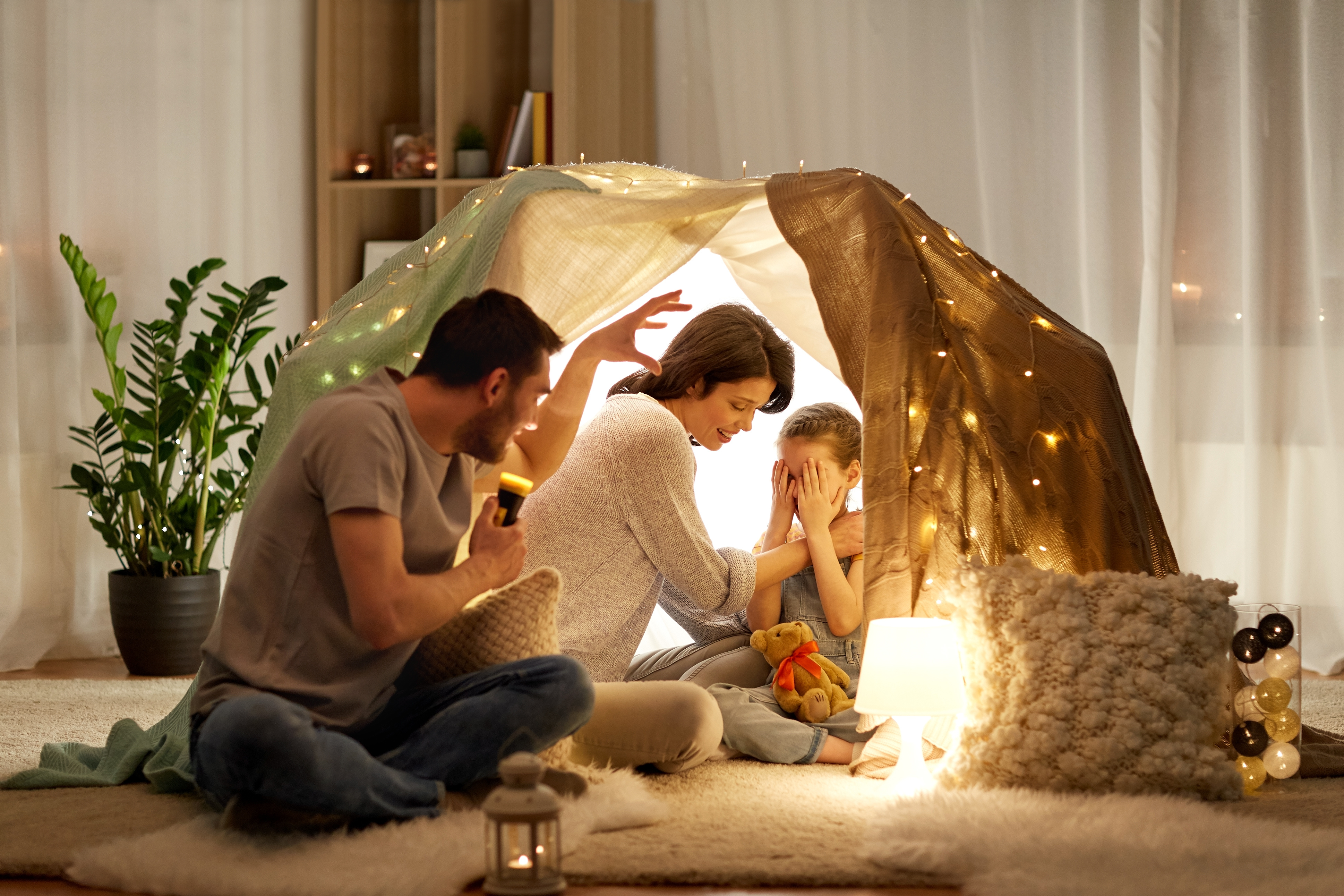 Family playing in indoor tent