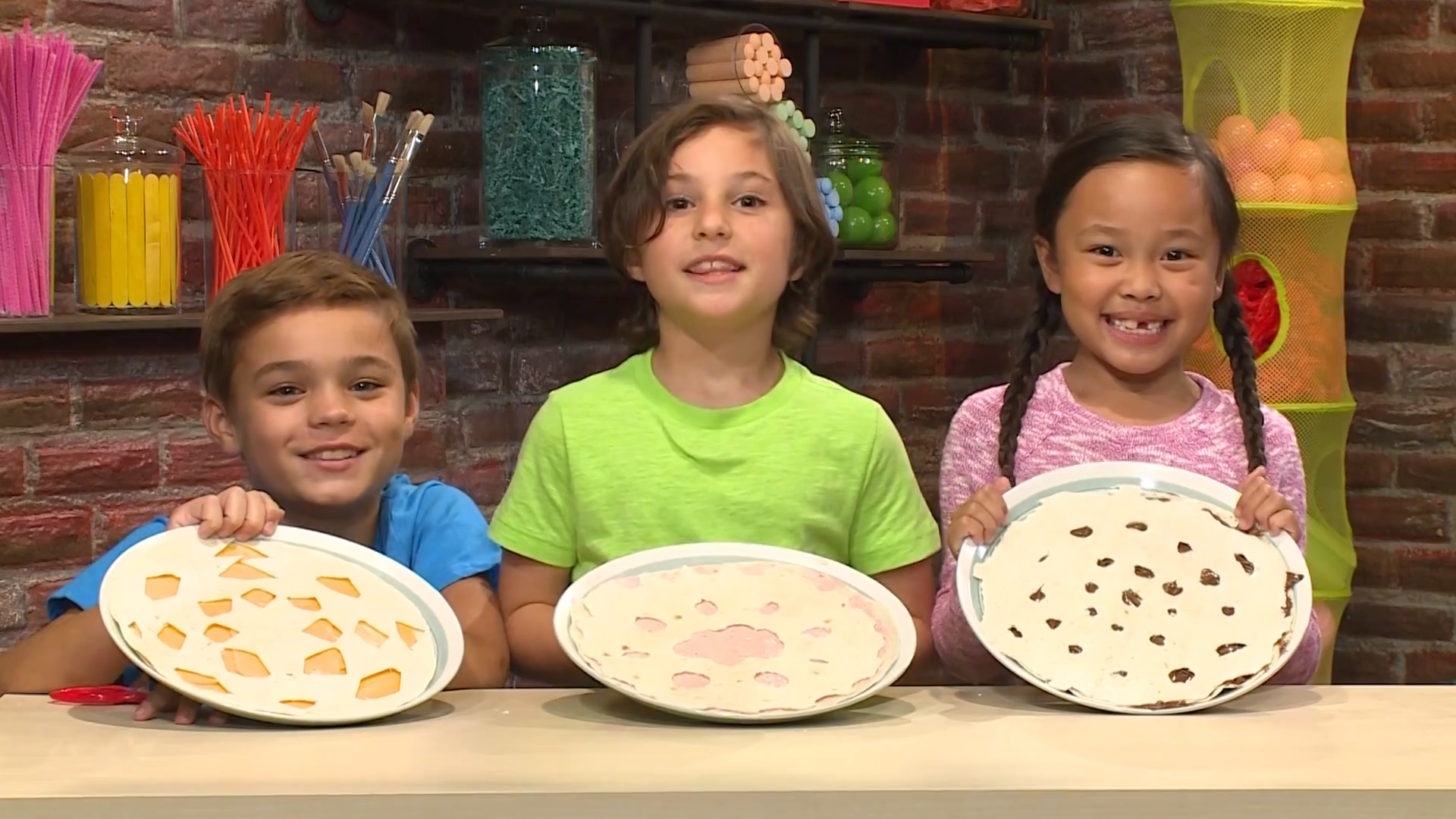 Photo of Children Holding Up Snowflake Tortillas