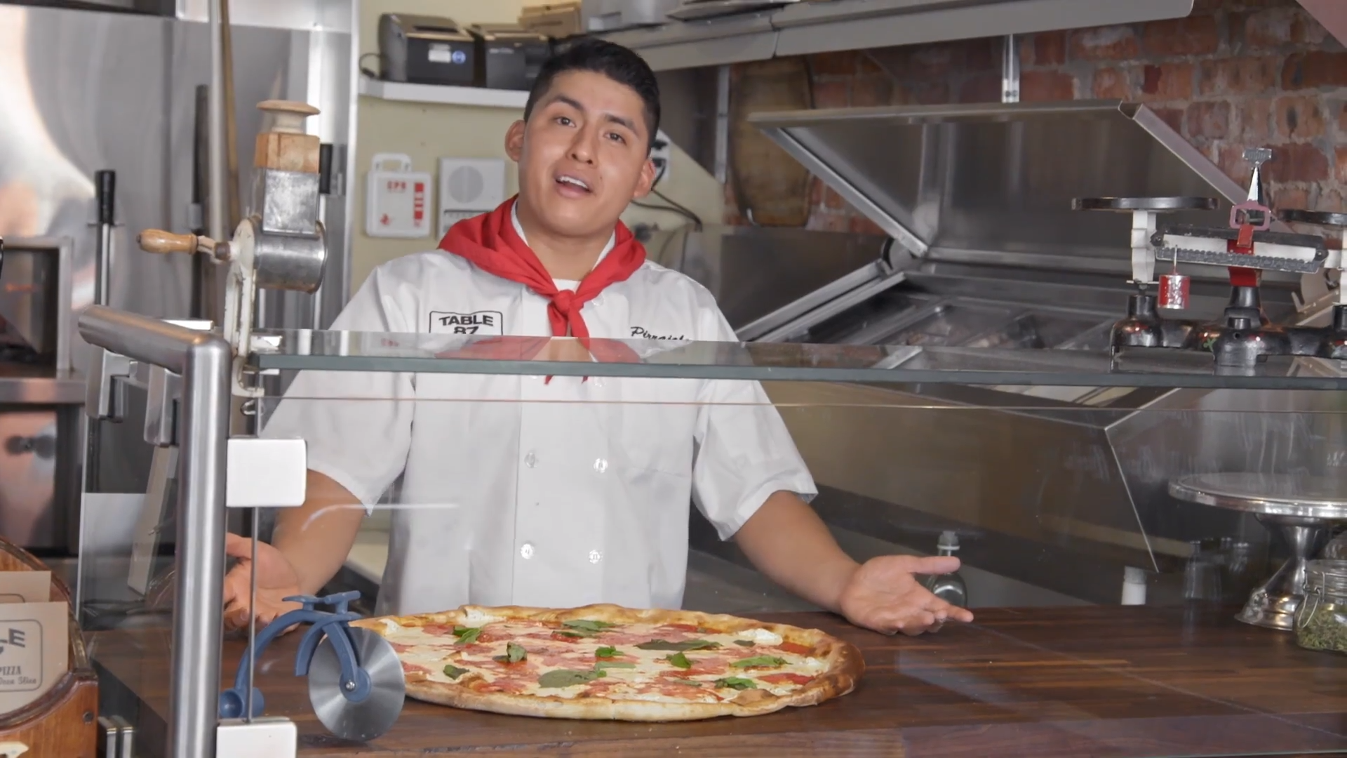 Pizza crafts - pizza chef behind counter