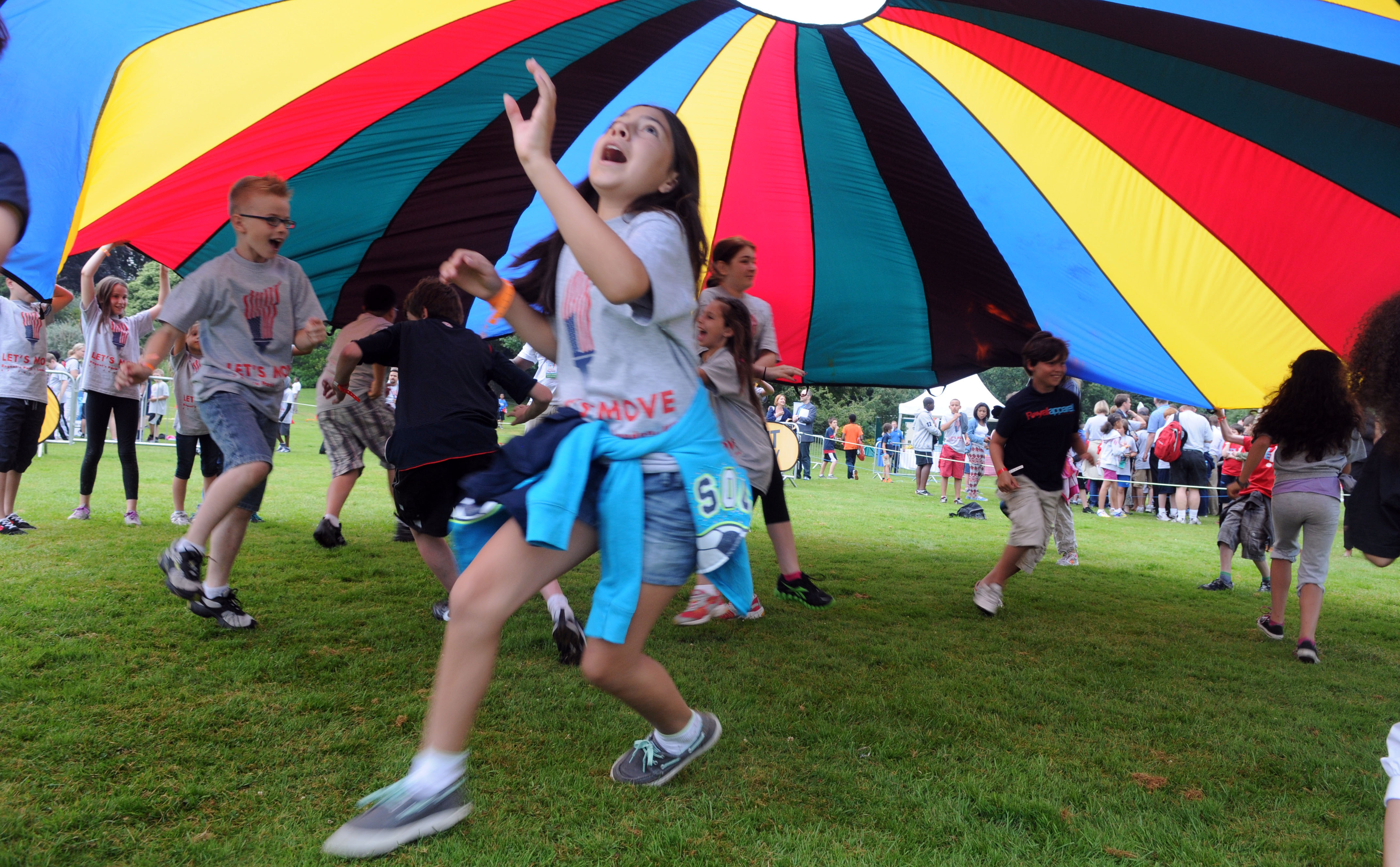 Children playing parachute game