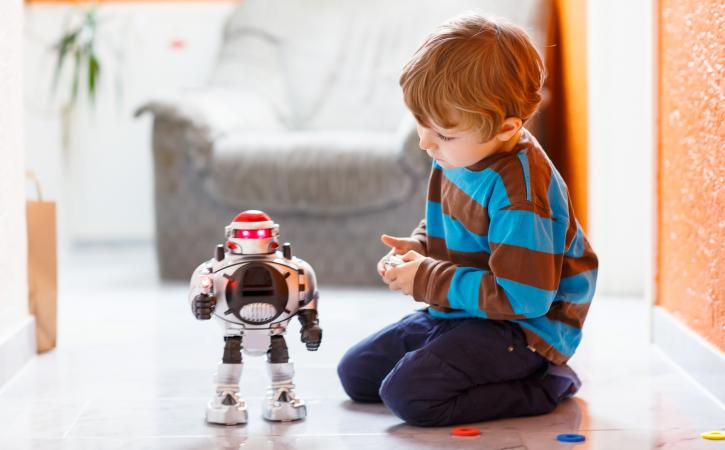 What Is Coding for Kids - Little boy plays with robot