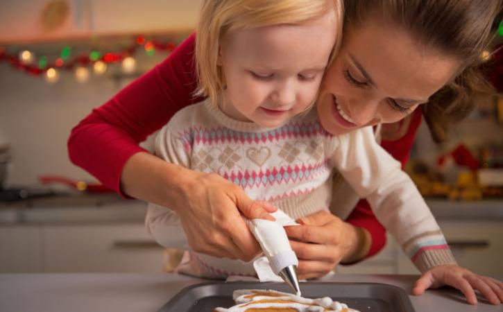 Little girl and her mother baking gingerbread men